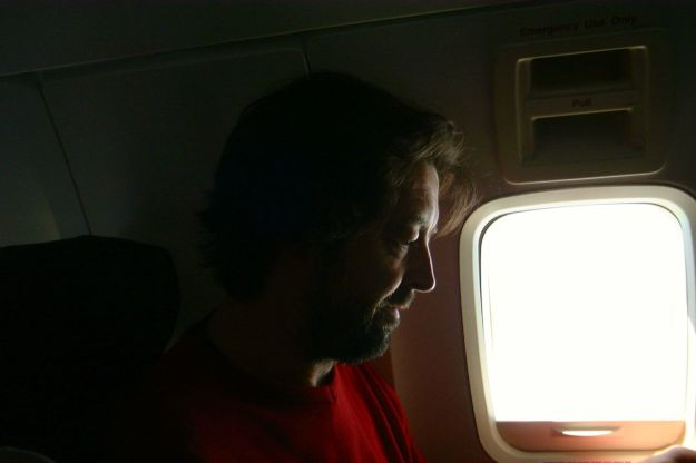 Editing a film on the plane from San Francisco to Portland, 2002.