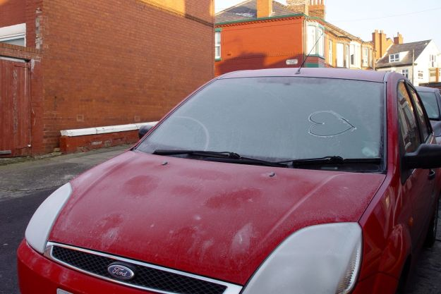 Car's all iced up anyway. Sarah's been drawing in the frost.