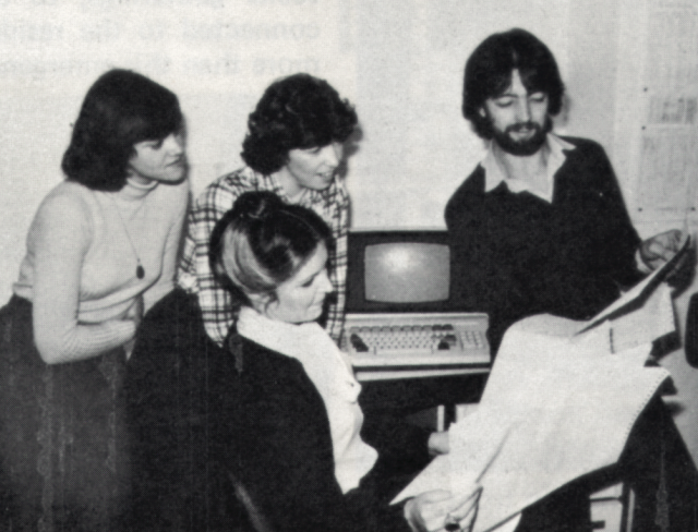 Me at 24, showing Jane Bush, Cathy Wiggins and Lorna Ely a pile of paper. Behind us sits the computer, all 10 megabytes of it.