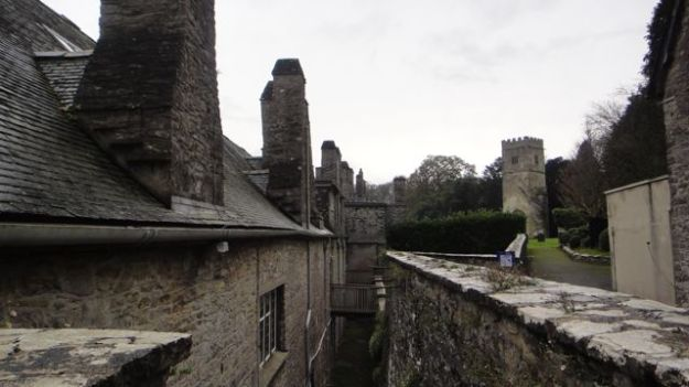The back of the west wing is a jumble of ancient walls and chimneys.