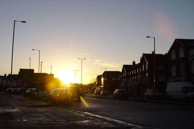 A low winter sun rises over Allerton Road.