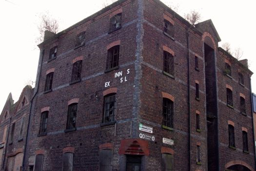 These former docks warehouses look very old, but I suspect I'll find this was built after the years I'm looking at.