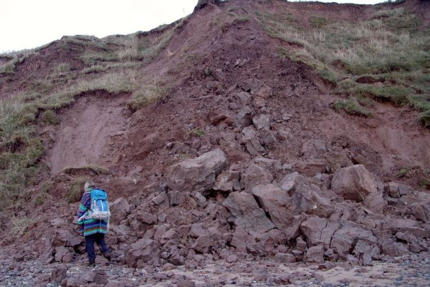Sarah surveys the erosion. Just to give you a sense of scale.