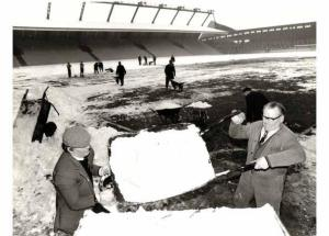 Clearing snow off the pitch at Anfield, January 1979.
