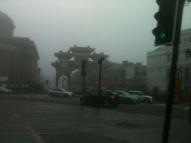 Down the hill at Upper Duke Street, and the fog clearing slightly down at Chinatown.