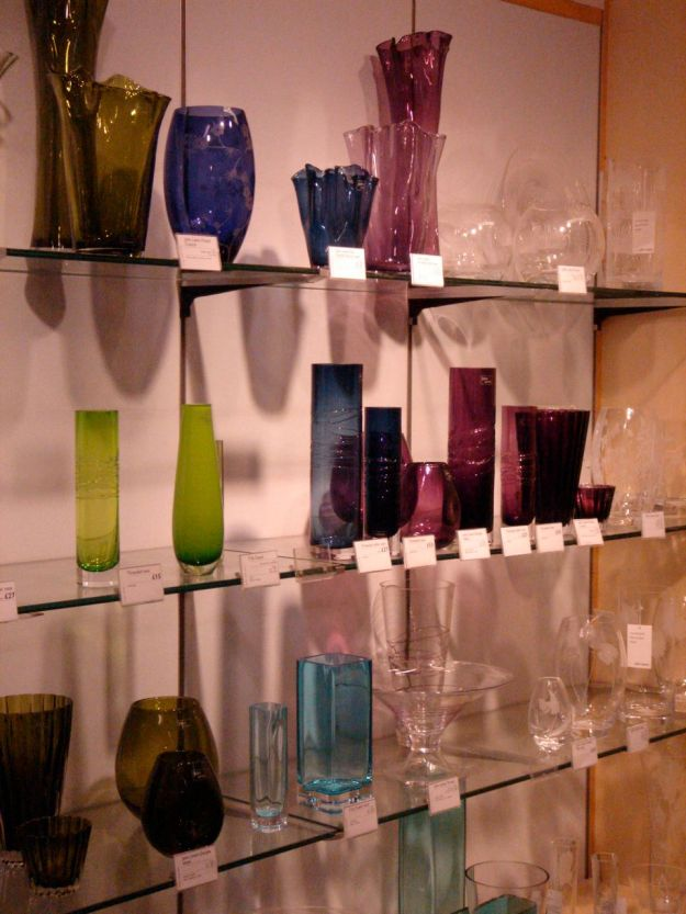A small selection of coloured glass vases.