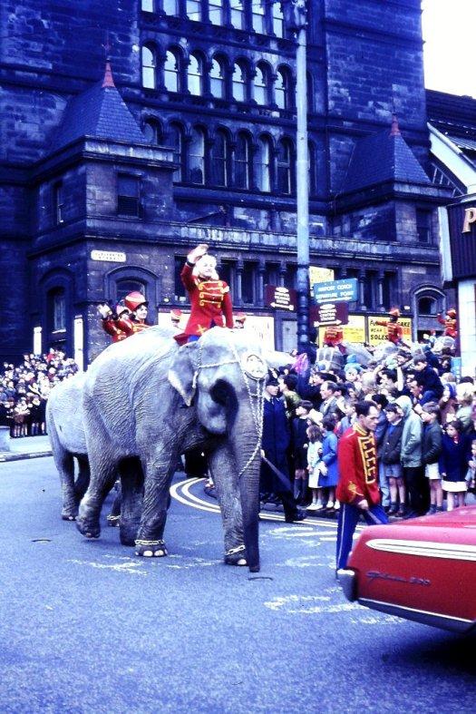 Same riders, same lead elephant, back of same car - 1966.