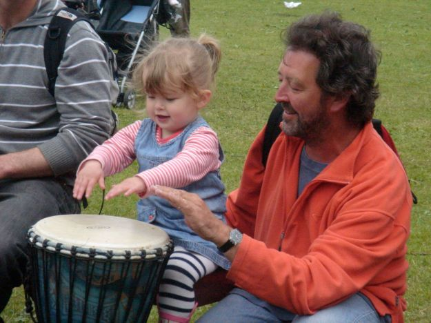 Africa Oyé 2008. My granddaughter Ellie learns to drum.