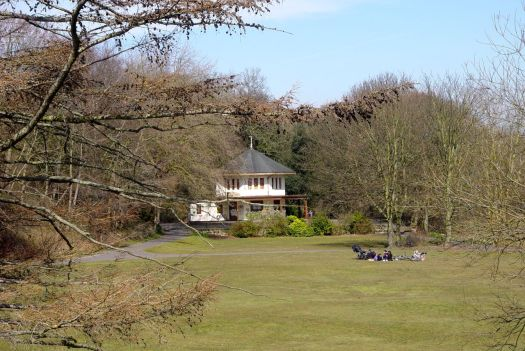 A family picnics by a disused café, where Otterspool House used to stand.