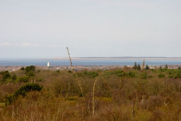 Looking across past Leasowe Lighthouse, to Formby Point, far across Liverpool Bay.