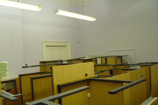 A lovely Georgian room filled with unlovely discarded desks.