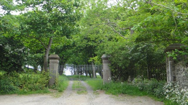 Past ancient gates behind which the ancient house has been long absent.