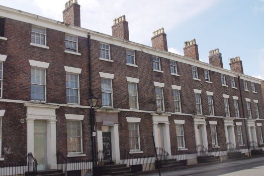 Into Percy Street, where a terrace of Georgian houses is worryingly empty.