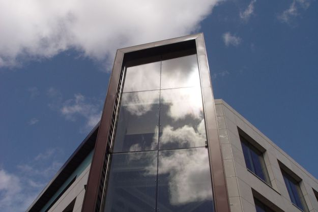Clouds reflected in the new building going up on the corner of Church Street and Whitechapel.