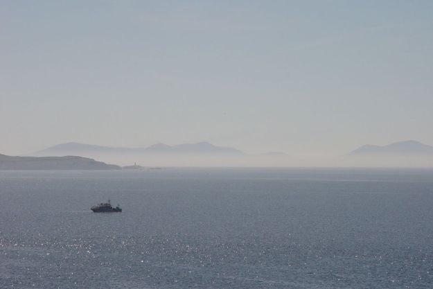 And off in the distance Snowdonia hovered in a heat haze.