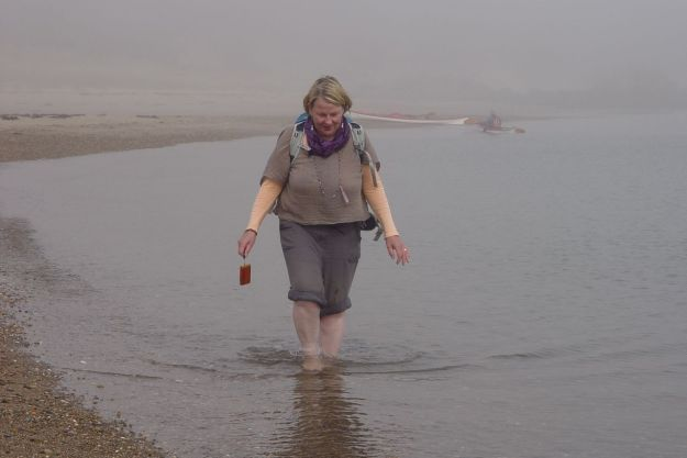 Sarah walks peacefully through the still water. Having a happy birthday.