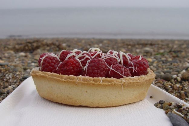 A raspberry and white chocolate tart.