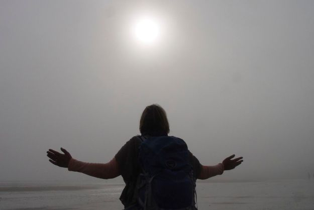 Walking back along the beach Sarah makes a special birthday plea for the sun to break through.