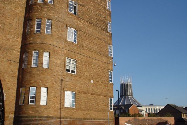 A great Liverpool tenement survives. Student housing now, with the Catholic Cathedral shining in the background.