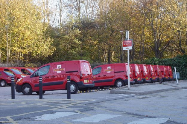 Red Royal Mail vans in the Wellington Road sorting office.