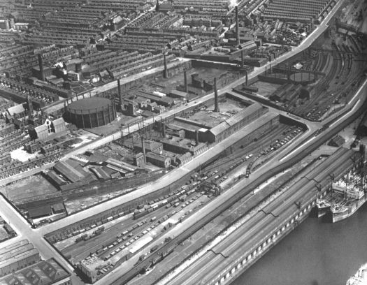 An aerial view from the 1920s or 30s. Toxteth Dock in the bottom right corner. The Overhead railway running alongside it.