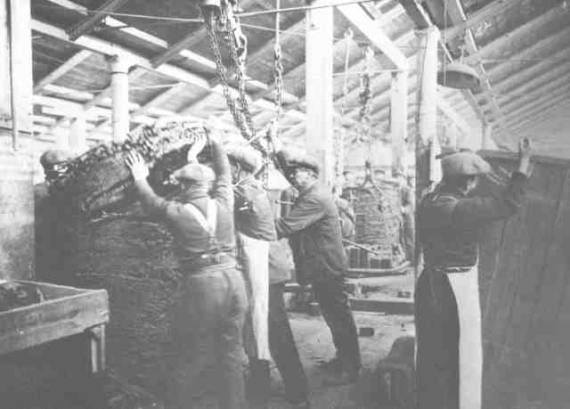 Working inside on the tobacco, 1920s.