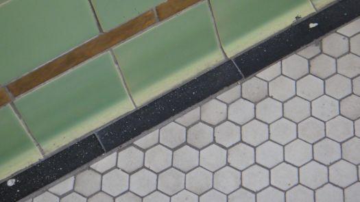 The tiles on the floor.