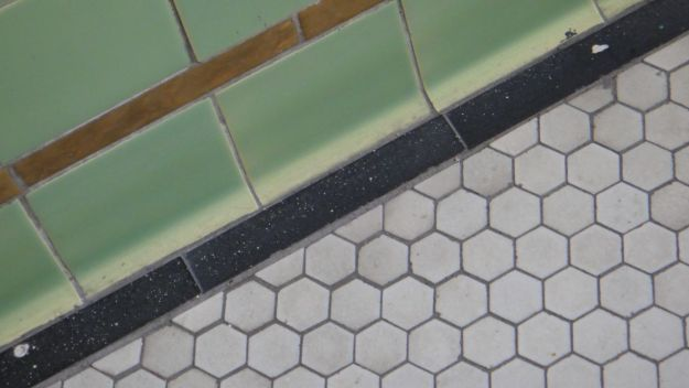 The tiles on the floor.