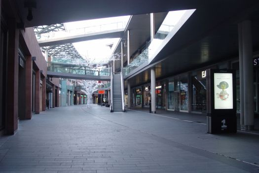Walking back past Liverpool One, adverts still playing to the emptiness.