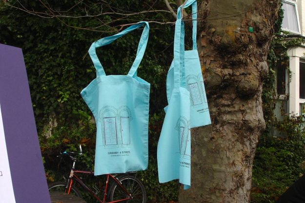 The Community Land Trust bags, designed by Hannah, hanging up to dry.