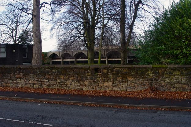 Behind this old wall are the University's 'Carnatic Halls.'