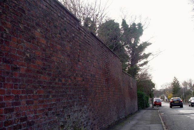 And at the end of a tall, forbidding wall...