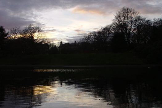 By the lake in Sefton Park as the sun goes down.