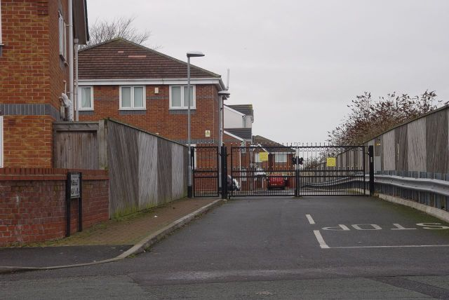 Further along Mill Lane, an unwelcome sight, a gated estate.