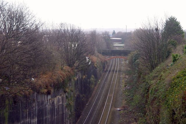 Just next to this deep railway ravine with allotments next to it.