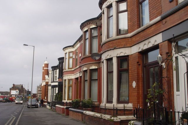 The Road Home: Past these typical Liverpool terraces.