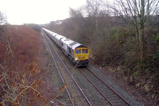 Crossing the railway. Good to see such a long goods train. Makes a lot more sense than a load of trucks on the road.