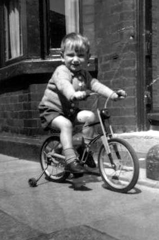 And Barry on his first bike, in Walton in the 1950s.