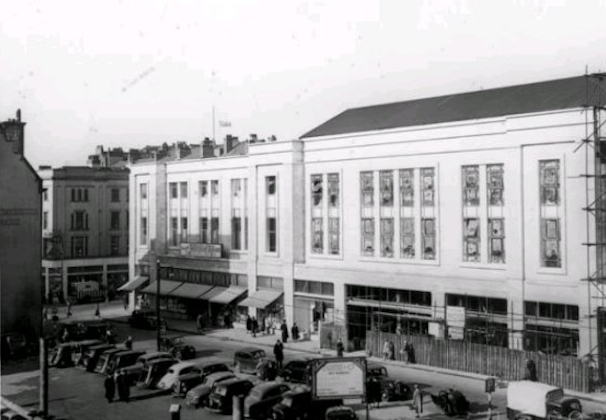 Bomb site car parking in 1954 opposite Blackler's Department Store.