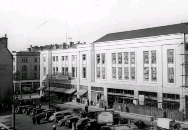 Bomb site car parking in 1954 opposite Blackler's Department Store.