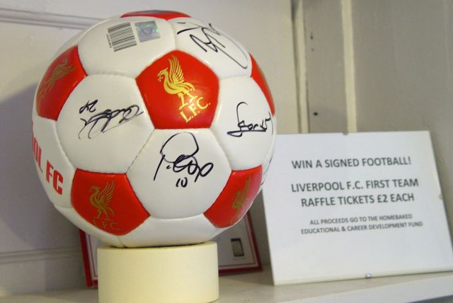Signed by all of the Liverpool first team, for Homebaked.
