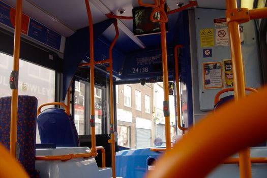 At the top of Oakfield Road I get on a number 14 bus to town.