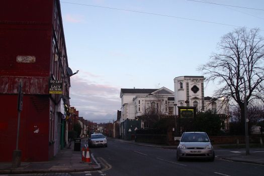 Past Dovedale Towers and the shops.