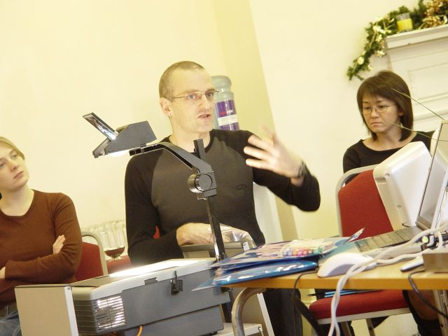 Look out. it's a man with an overhead projector! Marianne, on the left, looks on sceptically.