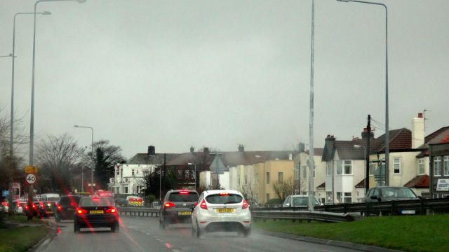 Out of the city through rainy Maghull.