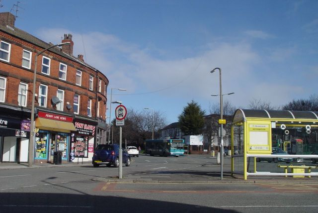 Waiting at the Penny Lane bus terminus, the 'Shelter in the middle of the roundabout'