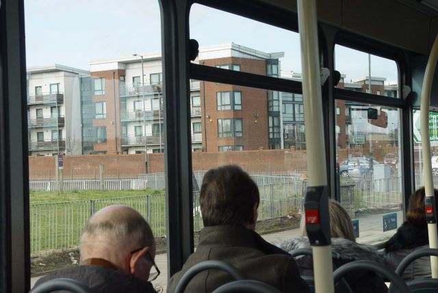 Across the East Lancs Road, past the new Coronation Court.