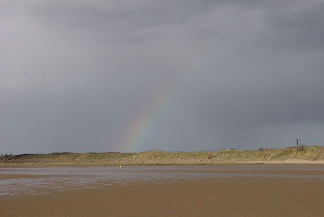 Only a few drops fall on us, but we are rewarded with a rainbow anyway.