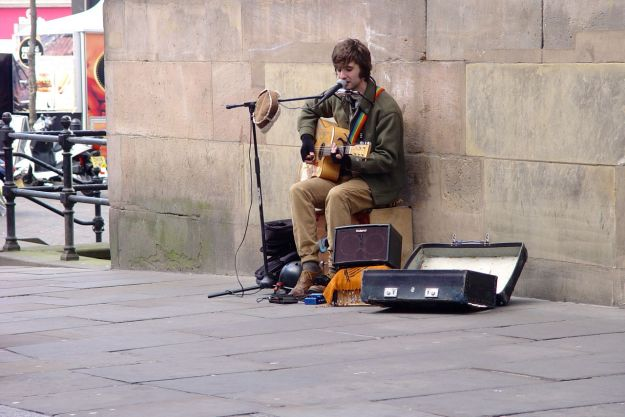 At the end of the street. Very high quality blues busking. The name on his guitar is 'Parker'