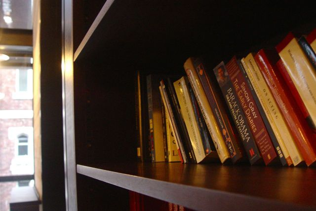 Welcoming touches like books to make you want to come here for a good long sit.